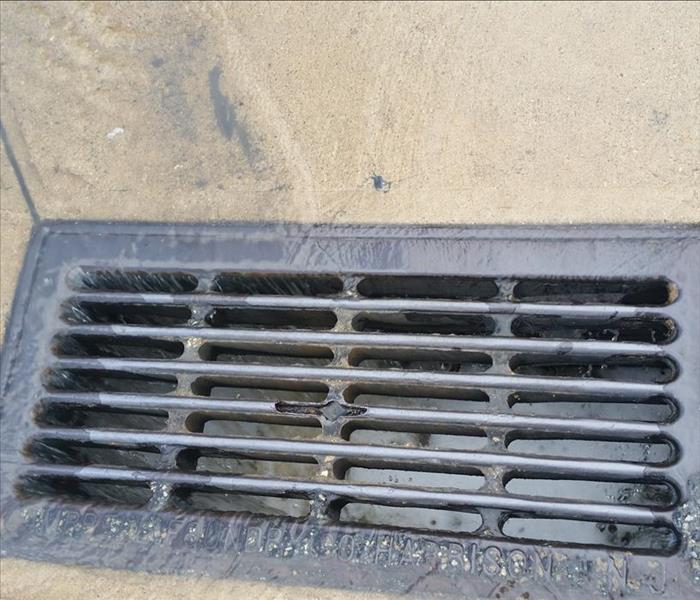 The water drained into this drain hole where we received clearance to do so.